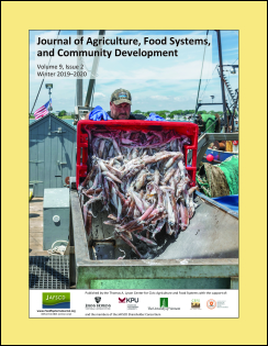Issue cover of Rhode Island fisherman dumping catch of squid